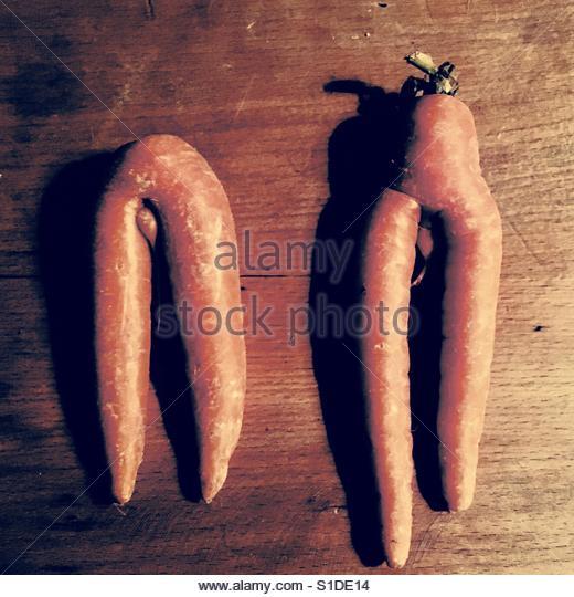 Carrots in the shape of legs and lower torso. - Stock-Bilder
