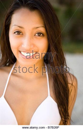 Portrait of Asian woman in bikini - Stock Image