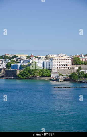 Puerto Rico view of Old San Juan as seen from arriving cruise ship in San Juan Bay, historic spanish architecture - Stock Image