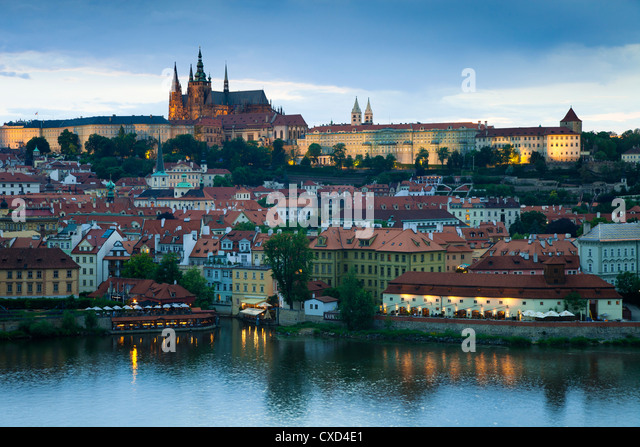 St. Vitus Cathedral, River Vltava and the Castle District illuminated in the evening, Prague, Czech Republic - Stock Image