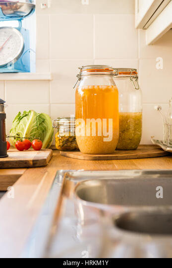 Homemade water Kefir, kimchi and sauerkraut, prebiotics and probiotics that support gut health and improve the immune - Stock Image