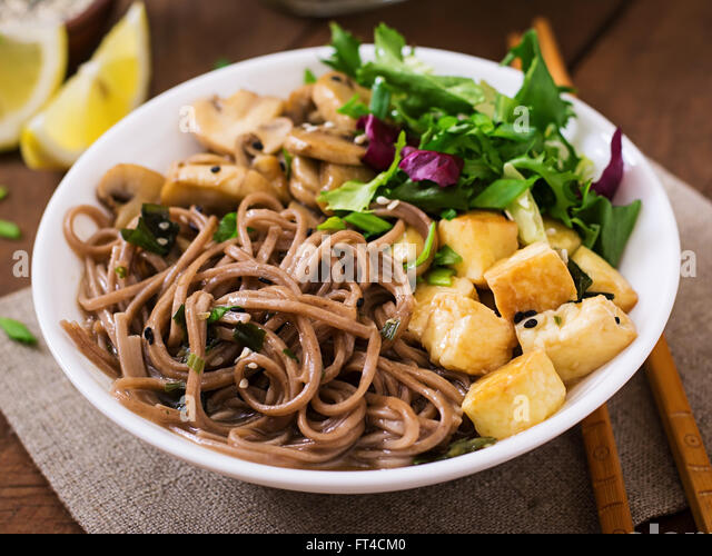 Miso and soba noodle soup with roasted tofu and mushrooms - Stock Image