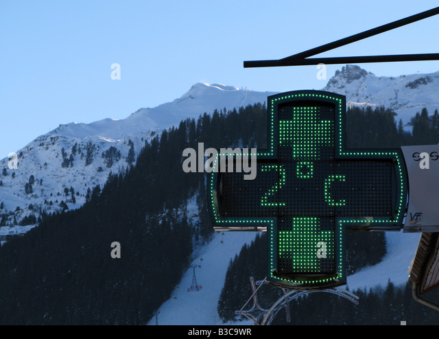 A pharmacy sign in Meribel France - Stock Image