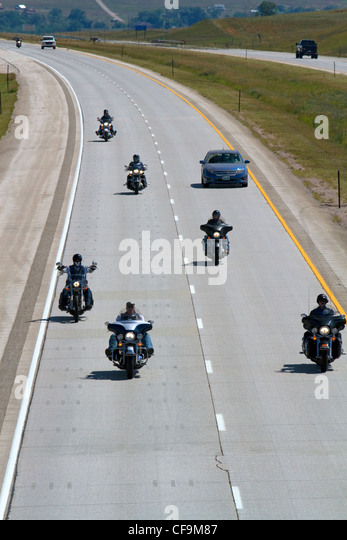 Motorcycles and automobiles travel on I-90 during Sturgis Motorcycle rally week west of Spearfish, South Dakota, - Stock-Bilder
