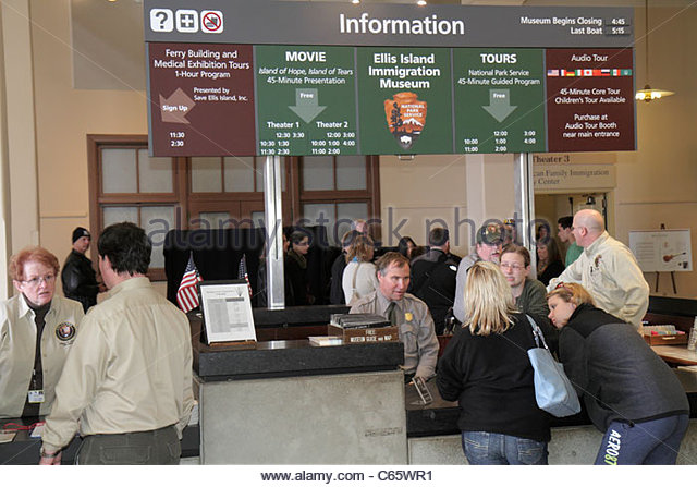 New York New York City NYC Statue of Liberty National Monument Ellis Island Immigration Museum information desk - Stock Image