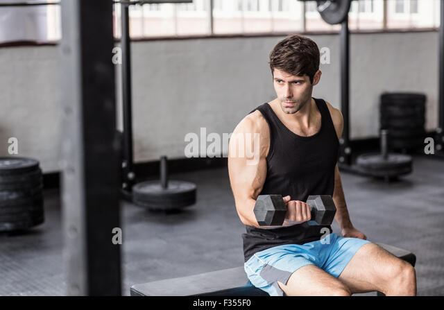 Young Bodybuilder doing weightlifting - Stock Image
