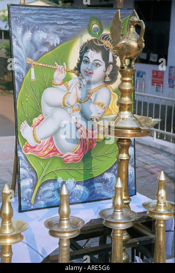 a wall painting of young lord krishna with a flute . India , Kerala , a state on the tropical coast of south west - Stock Image