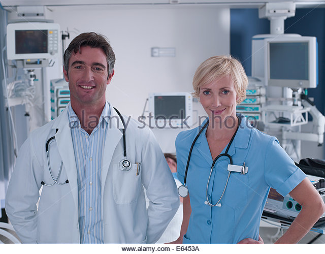 Doctor and nurse standing in intensive care - Stock Image