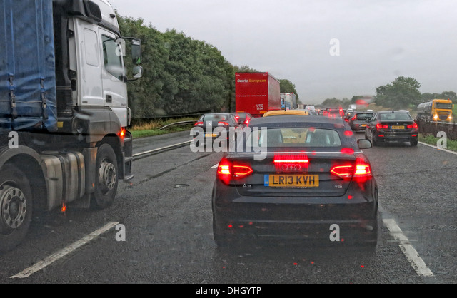 Cars on a Motorway Road in very wet weather M6 Cheshire - Stock Image