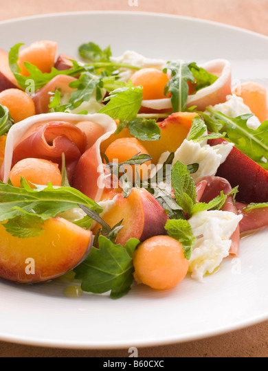 Platter of Cantaloupe Melon Parma Ham Mozzarella Cheese and Peach - Stock Image