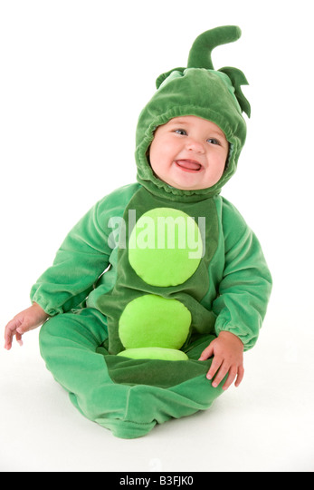 Baby in peas in pod costume smiling - Stock Image