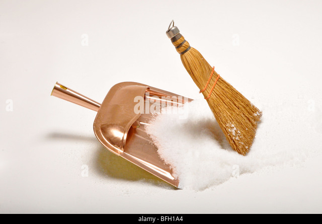 dust pan and whisk broom sweep up white snow, no people. - Stock Image