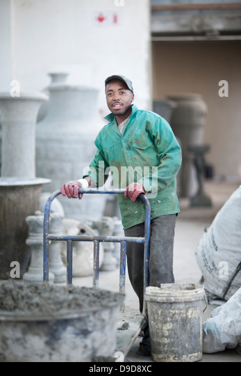 Delivering raw material in pottery factory - Stock Image