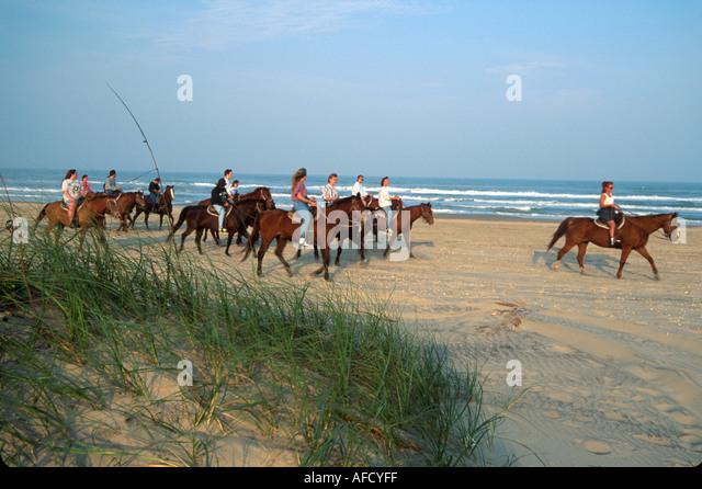 Texas The Southwest Gulf of Mexico South Padre Equestrian Center offers horseback riding on beach TX013 - Stock Image