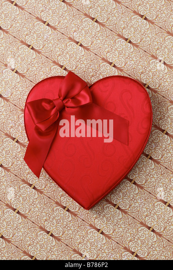 Valentine heart candy box with red bow - Stock Image