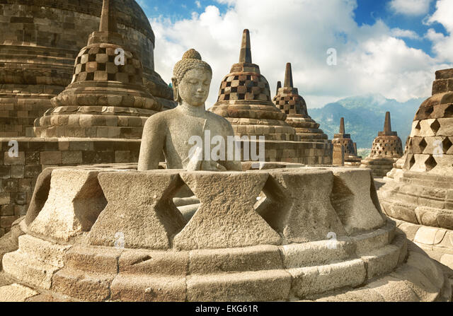 Buddha statue in stupa. Borobudur. Java. Indonesia - Stock Image