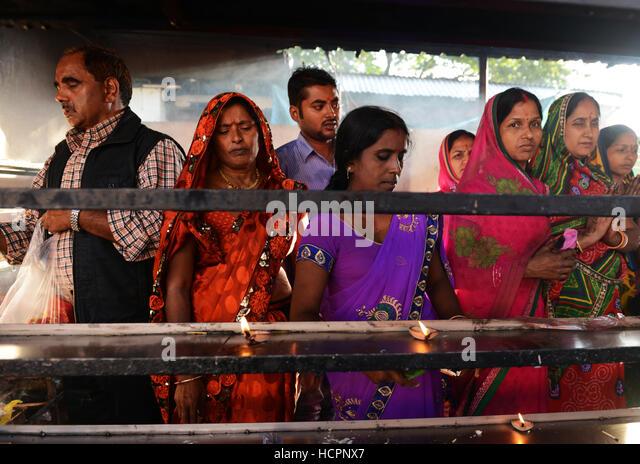 Hindu pilgrims performing a puja ceremony in Kamakhya temple Assam. - Stock Image