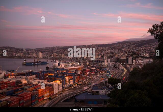 View of city and ports at dusk from Paseo 21 de Mayo, Cerro Playa Ancha, Valparaiso, Central Coast, Chile, South - Stock Image