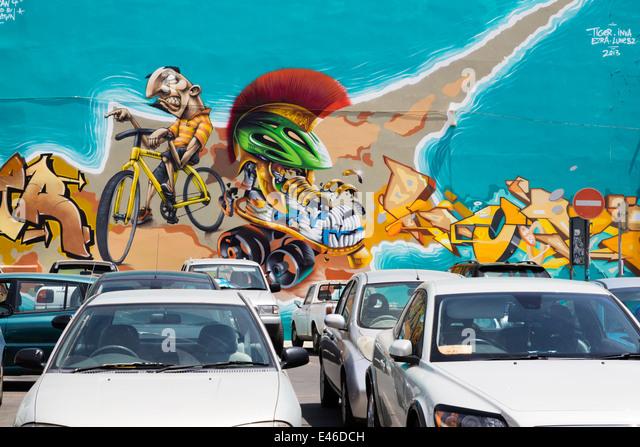Advertising grafitti on a whole house side, Larnaca, Cyprus. - Stock Image