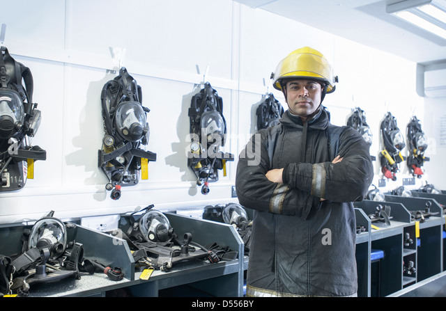 Firefighter standing in training room - Stock Image