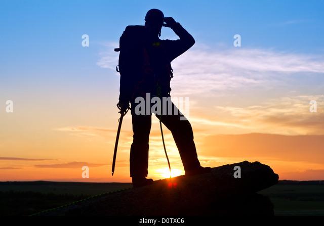 Silhouette climber - Stock Image