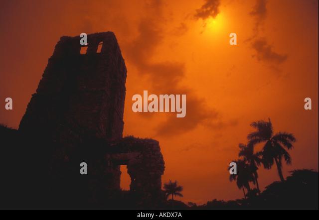 Republic of Panama old city Casco Viejo ruins orange silhouette tower palm trees - Stock Image