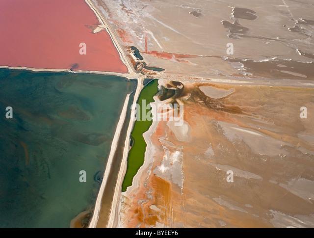 Aerial view of saline water at the salt works of Walvis Bay between Namib Desert and Atlantic Ocean. - Stock Image