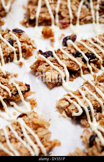 Homemade granola bars with fresh muesli and raisins - Stock Image