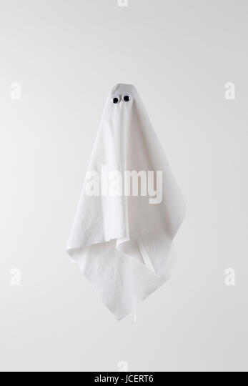white sheet ghost isolated on a white background. Tones on tones photography - Stock Image