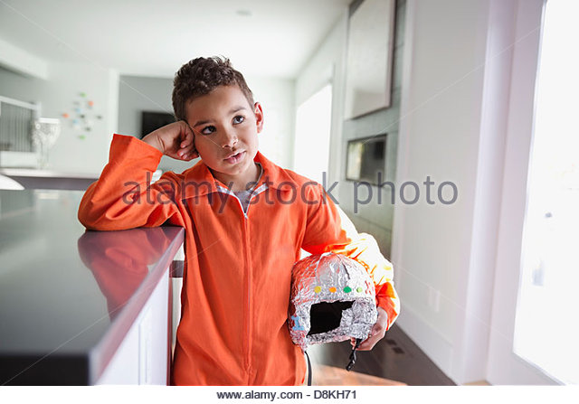 Boy pretending to be astronaut at home - Stock Image
