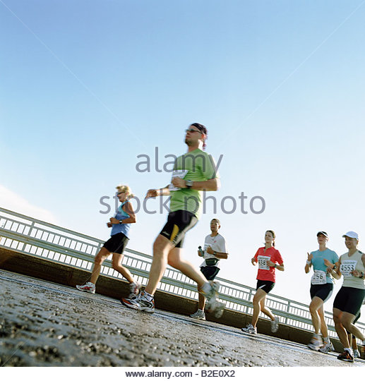 Group of people running in a marathon Helsinki Finland - Stock Image