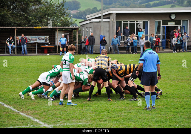 a scrum in a youth rugby match - Stock Image