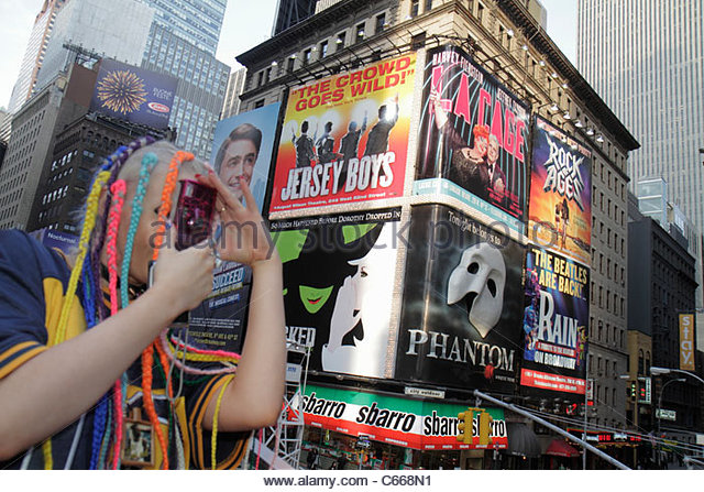 New York New York City NYC Midtown Manhattan Times Square Theatre District Broadway illuminated sign spectaculars - Stock Image