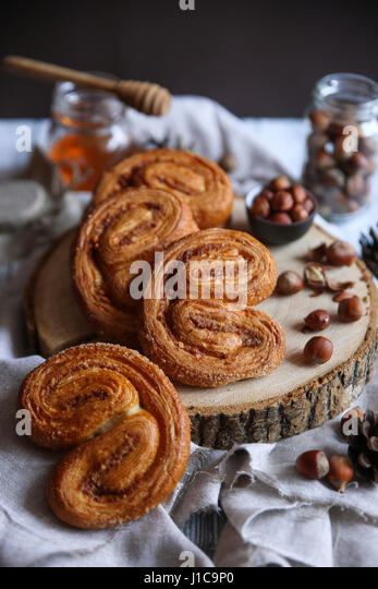 Pastry buns with nuts and honey - Stock Image