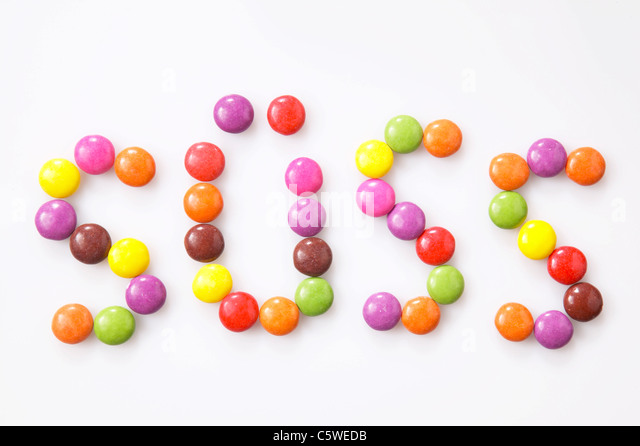 Multi-coloured candies, elevated view - Stock Image