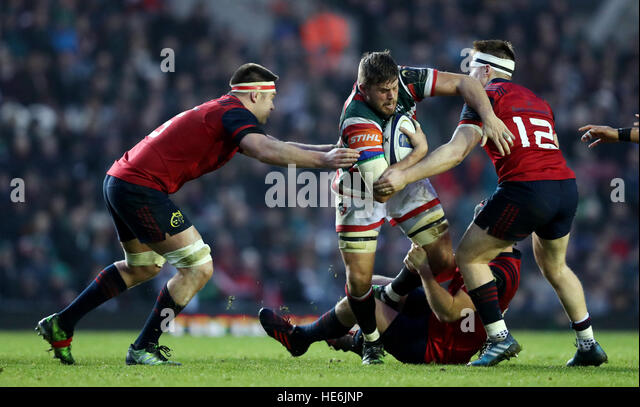 Leicester Tigers Ed Slater is tackled by Munster's Tyler Bleyendaal, Billy Hooland and Rory Scannell  during - Stock Image