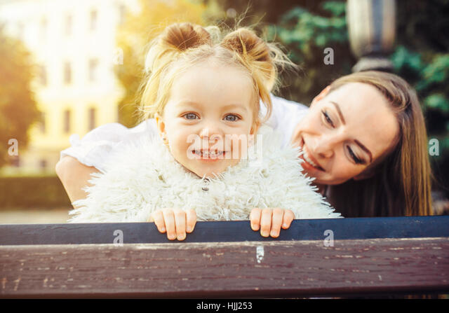 Mother and little daughter in a park - Stock Image