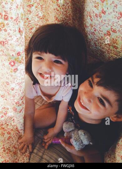 High Angle View Of Happy Siblings - Stock Image