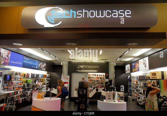 Boston Massachusetts Logan International Airport BOS gate area concourse shopping for sale display Tech Showcase - Stock Image