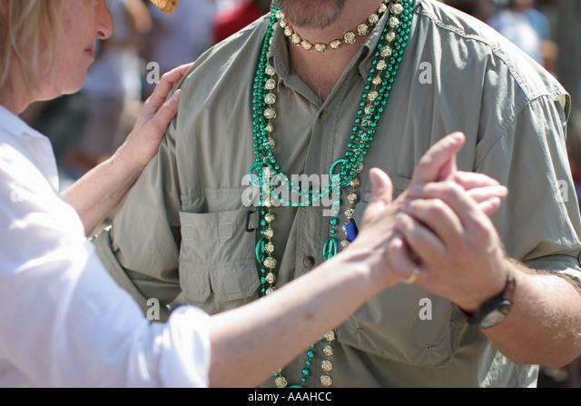 Florida, Zydeco Festival, Cajun, couple dancing, Mardi Gras beads, - Stock Image