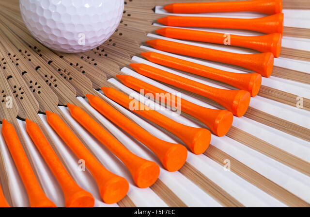 Typical Japanese hand fan made of bamboo and golf equipments - Stock-Bilder