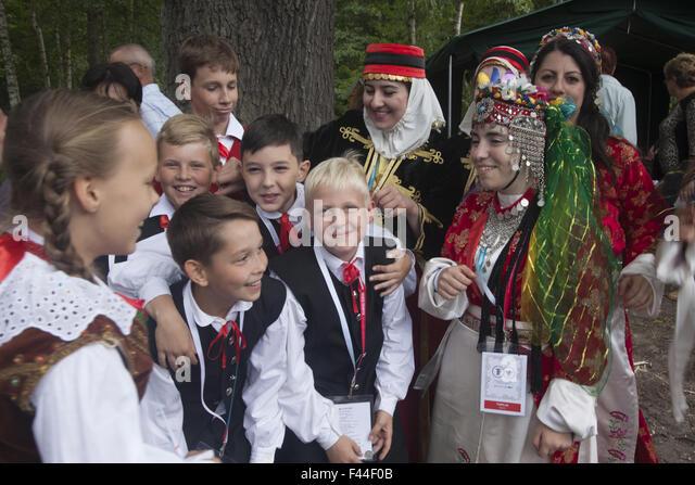 Turkish, Polish and other folk dancers at an International folk arts festival near Zielona Gora, Poland. - Stock-Bilder