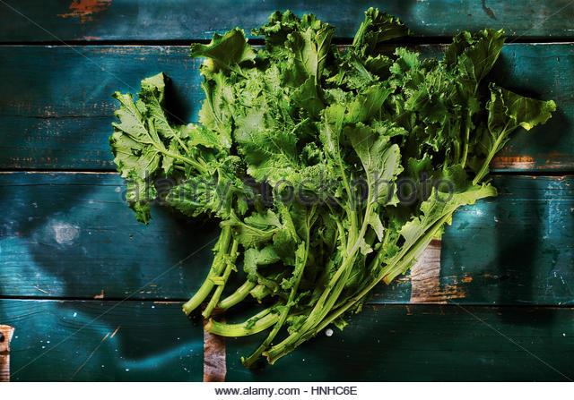 Fresh raw organic broccoli rabe - Stock Image