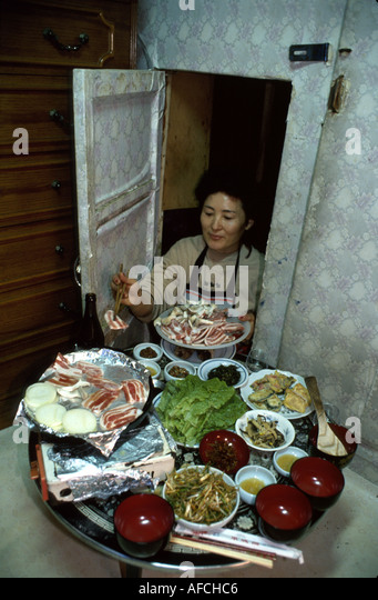 South Korea Asia Far East Seoul Asian woman prepares special meal Ondor Bong - Stock Image