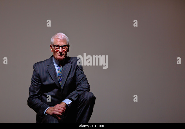 Studio portrait of cool senior man in suit - Stock-Bilder