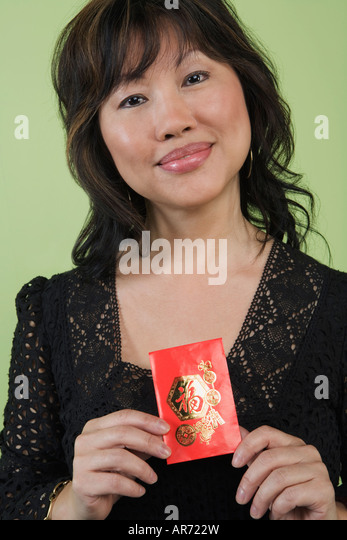 Woman holding red packet - Stock-Bilder