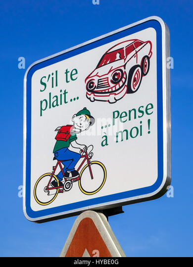 French roadsign advisory sign for motorists to be aware of young cyclists. - Stock Image