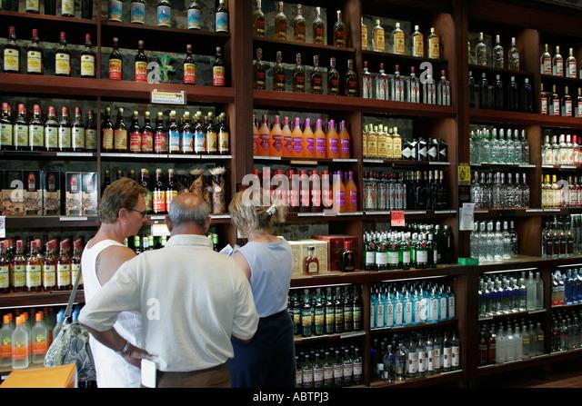 St. Thomas USVI Charlotte Amalie Main Street duty free shopping AH Riise Store liquor alcohol rum bottles - Stock Image