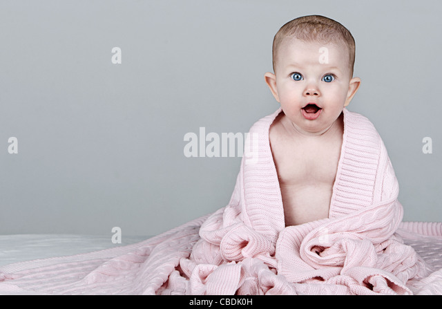 Beautiful Baby in Pink Blanet - Stock Image