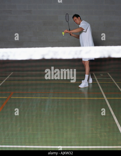 Man playing badminton - Stock Image